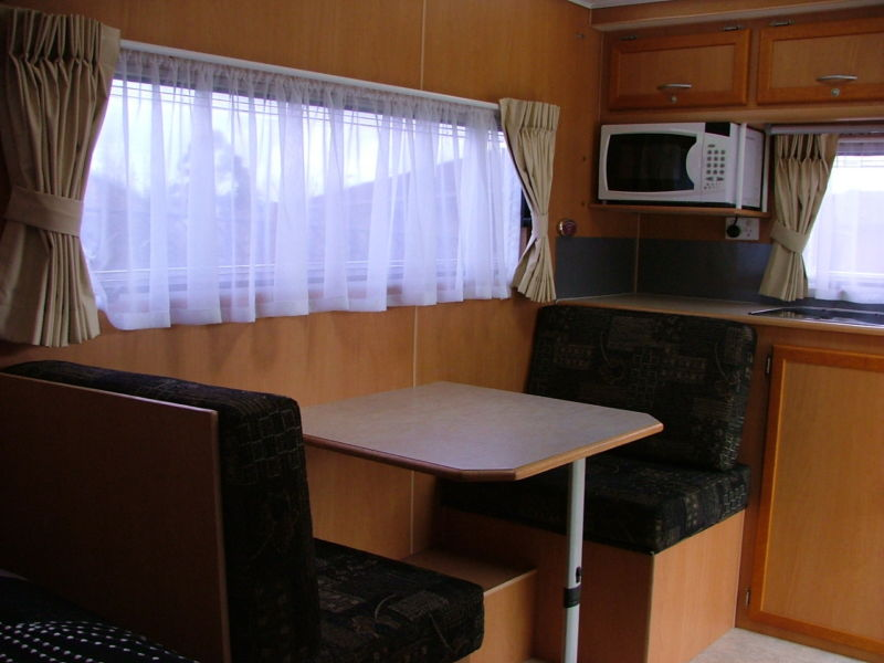 potentially-single-bed-table-kitchen