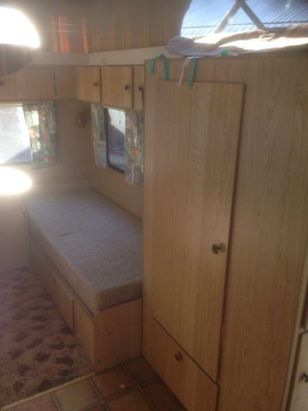 slim-mattress-above-storage-wardrobe-overhead-storage